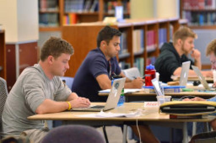 Students studying and writing