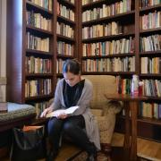 Student in library reading room