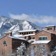 Campus buildings with flatirons in the background