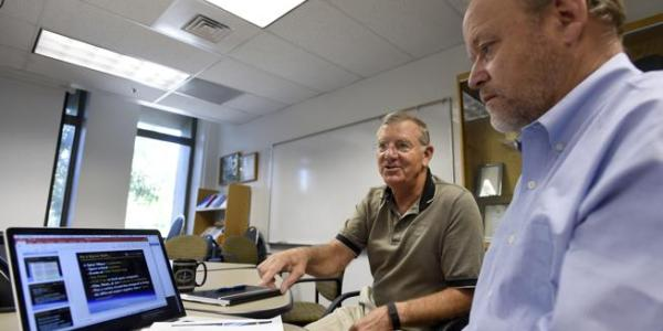 University of Colorado Scholar in Residence and former astronaut Jim Voss, left, sits Tuesday with Steve Nerem, faculty director for the newly created space minor at the University of Colorado at Boulder.