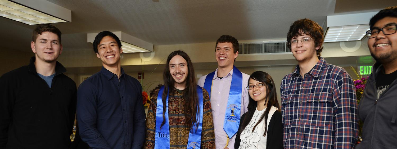 recent graduates share a laugh at a celebration dinner