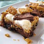Brownie topped with toasted marshmallows, graham cracker crumbles and hershey chocolate bars.