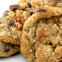 Close up of a batch of chocolate chip oatmeal cookies