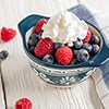 Small cup of berries and whipped cream