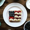 Toast with jam, cream cheese, bananas and blueberries