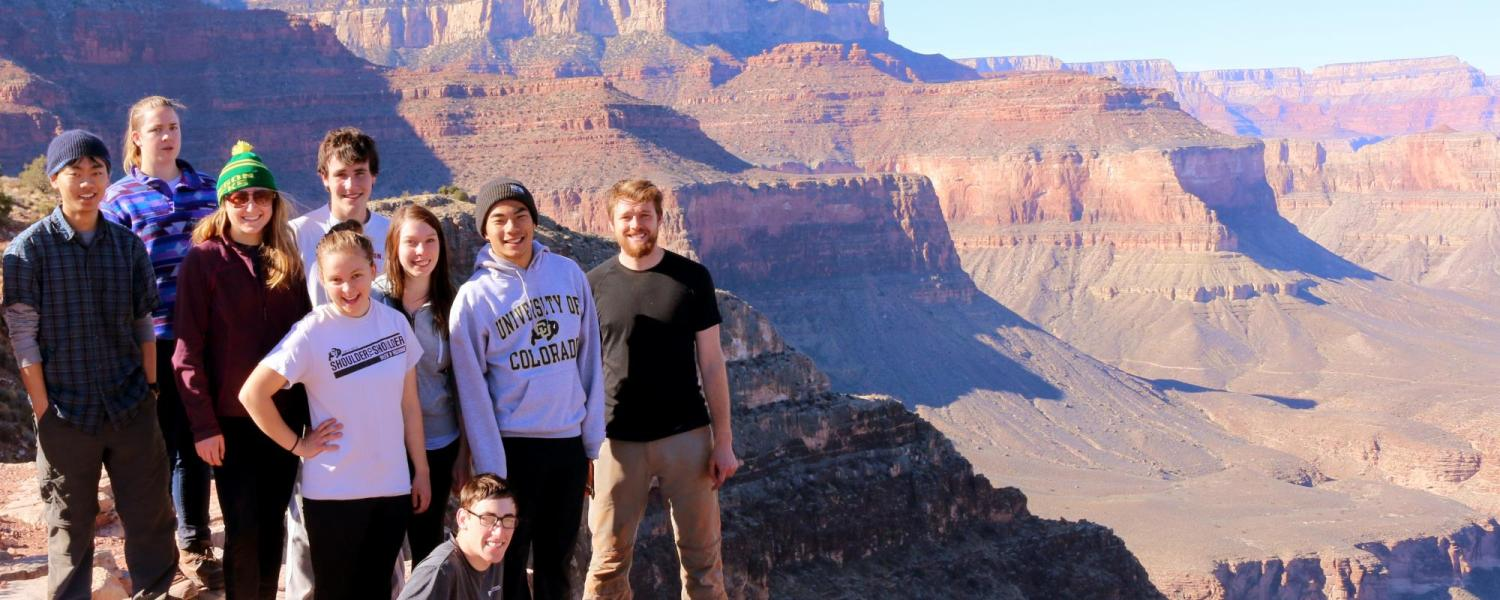 Students posing in front of rock formation in Moab.