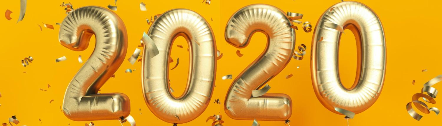 Gold balloons and confetti that spell out 2020