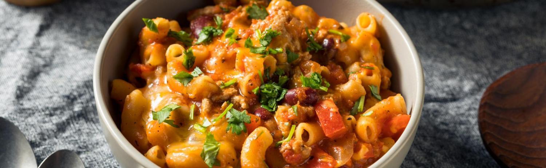 Mac and cheese bowl with chili and garnish
