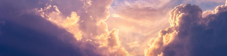 Sun peaking through storm clouds
