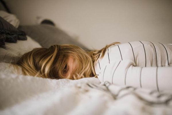 girl lying in bed