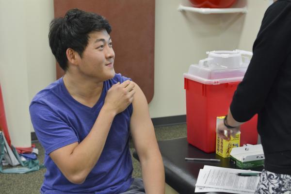 Student getting a flu shot