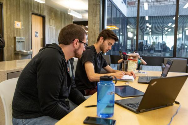 Two students sitting and studying
