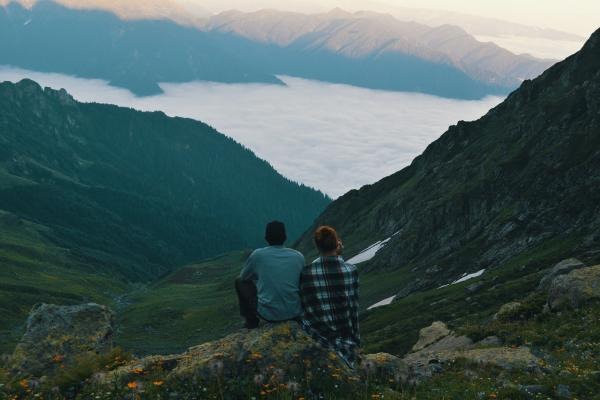 Two people looking over valley