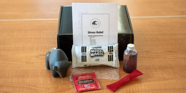 Box with stress relief supplies laid out around it