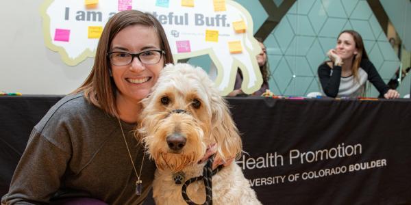 woman and a dog at the gratitude fair