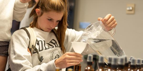 student pouring water