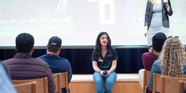 A student educator speaking to a classroom of Buffs.