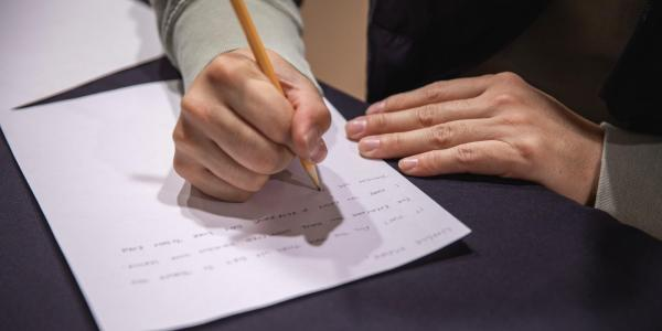 Student writing a rough draft of a paper.