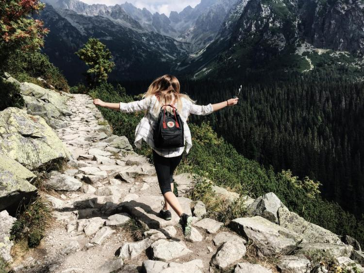 Person skipping while hiking