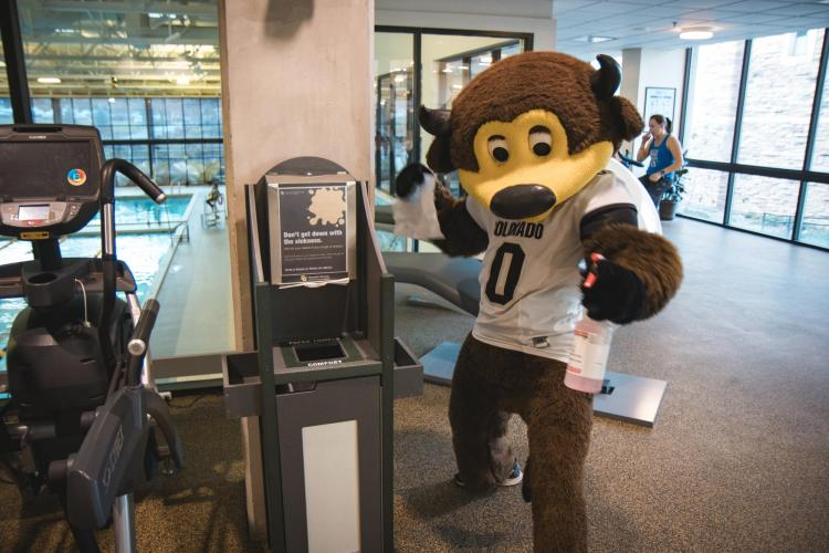 Chip the mascot with sanitizing equipment