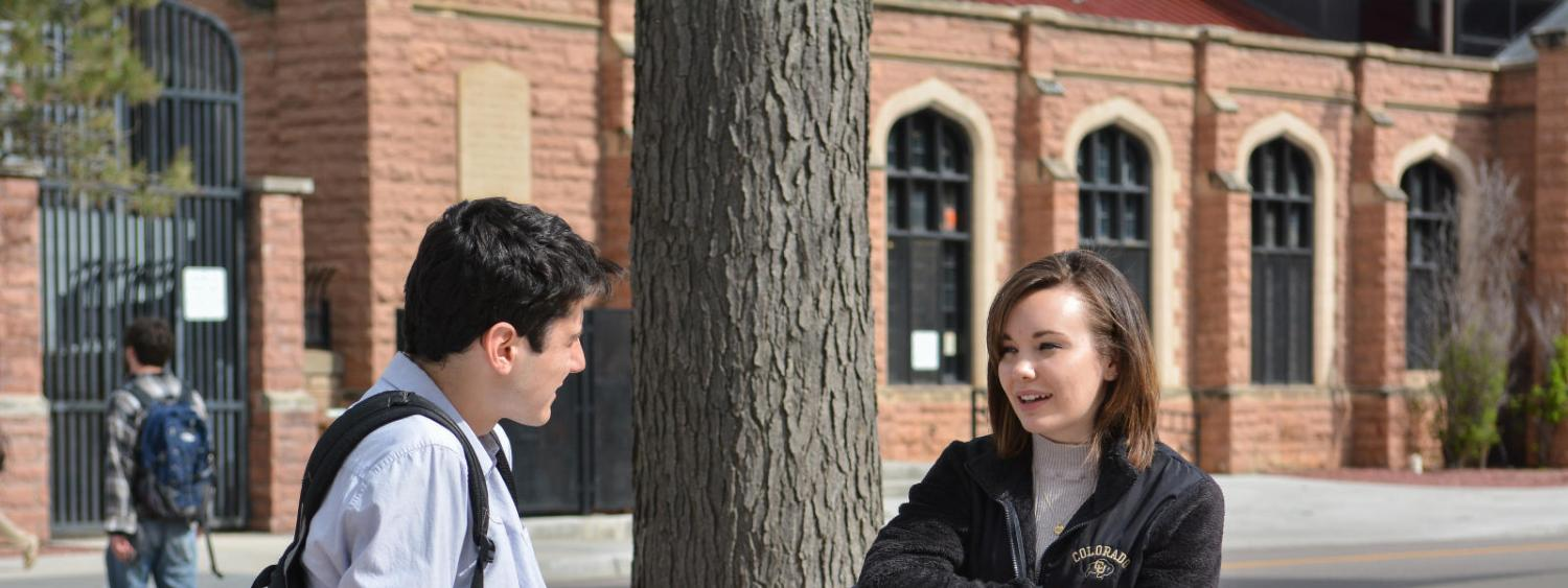 Two students talking outside