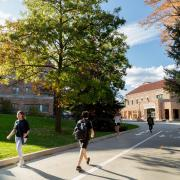Students walking apart from each other near the Rec Center on campus.
