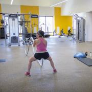 Female student using ropes in the functional fitness area