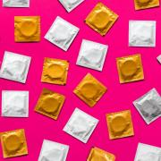 condoms on colorful background