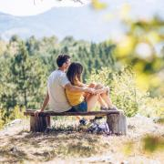 Couple sitting on a bench after a hike