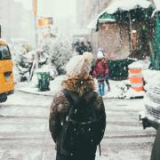 Girl in beanie standing outside in the snow