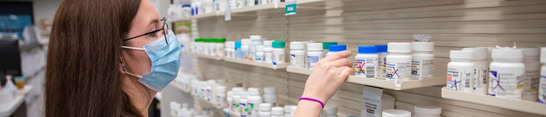 a pharmacist choosing pills