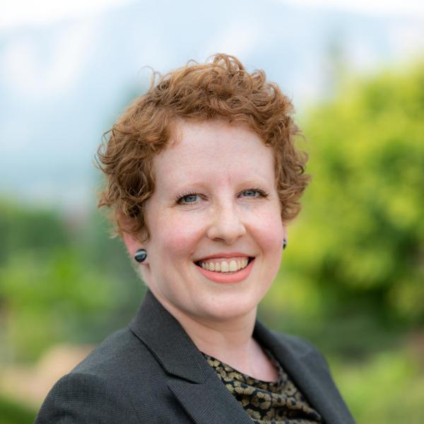 smiling redhead woman: kate mackrell