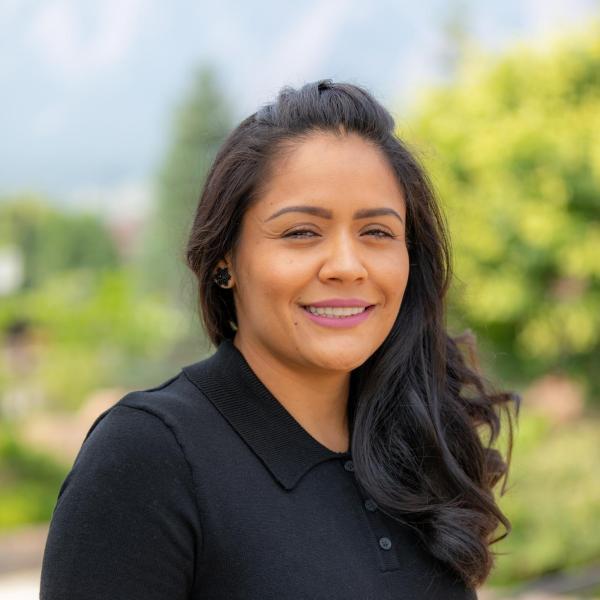 smiling woman with dark hair: maria lozano almanza