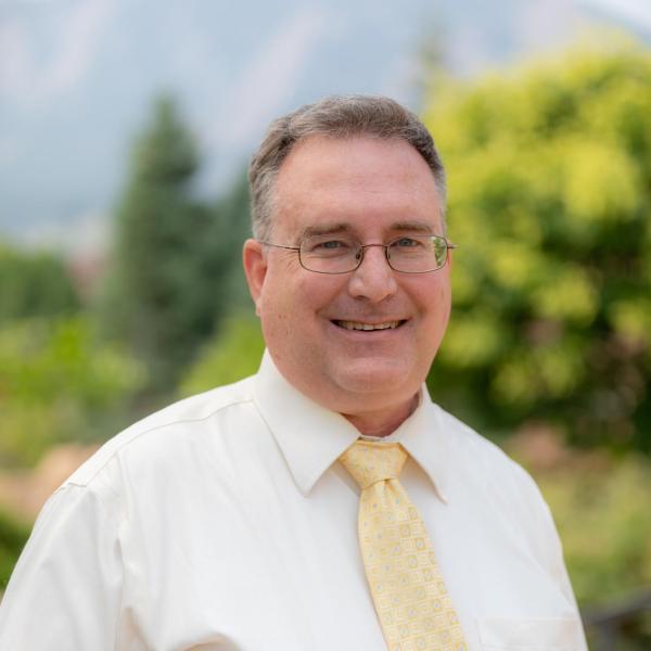 smiling man in a tie tony wilk