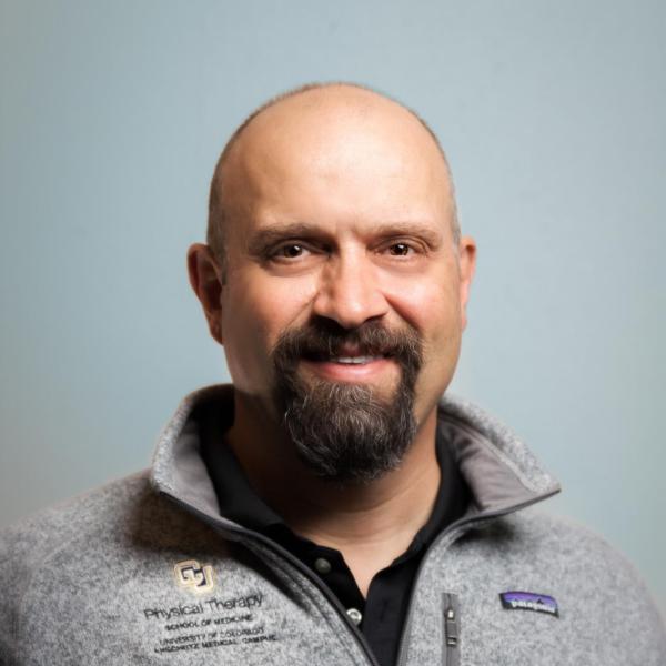 smiling bald man with a circle beard