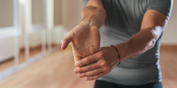 person stretching their wrist