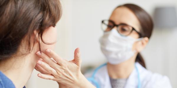 nurse checking on woman
