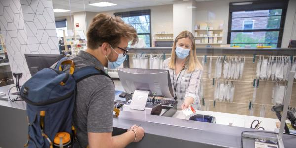 student at the pharmacy