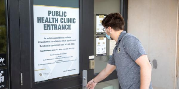 student entering the public health clinic