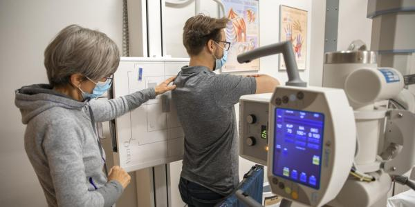 student getting an x ray of his back taken