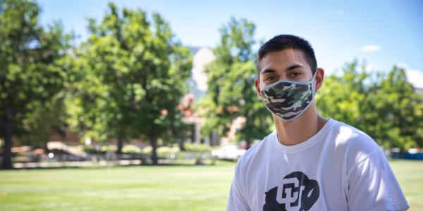man in CU shirt with a mask on