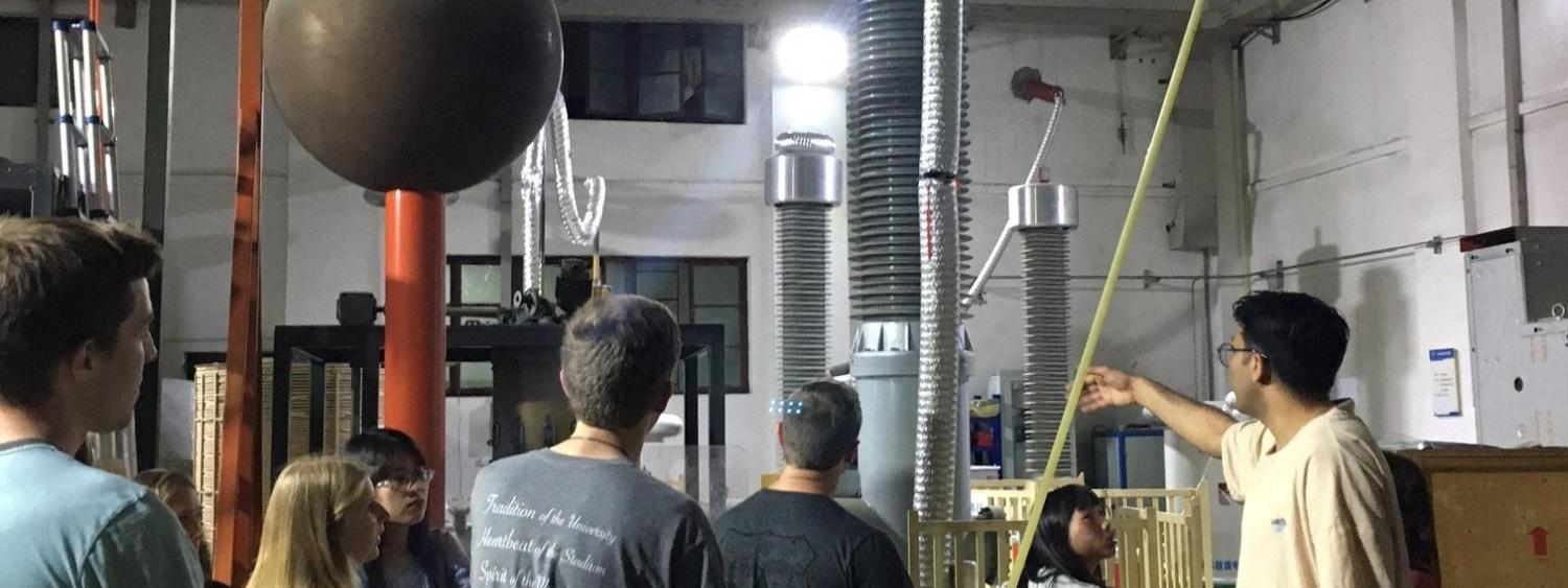 Students at a laboratory to examine large Tesla coils
