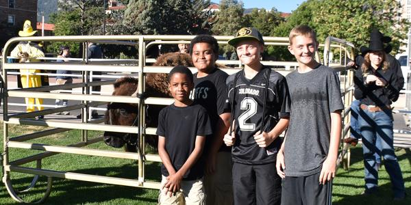 Young CU fans hang out with Ralphie at Ralphie's Corral.