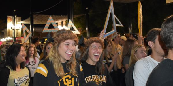 Students celebrate during the 2015 Homecoming parade on Pearl Street.