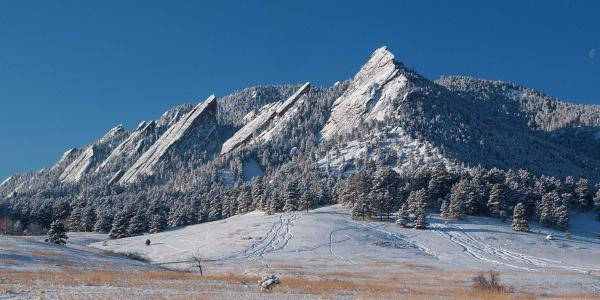 The Flatirons over Boulder on a snowy day.