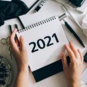 hands holding 2021 calendar
