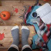 Thick socks, book and coffee cup