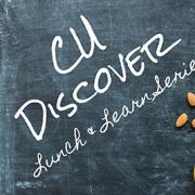 CU Discover written on table top with food on it