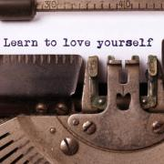 "Typewritten ""learn to love yourself"""