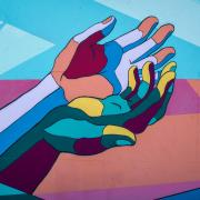 Mural of hands in rainbow of colors